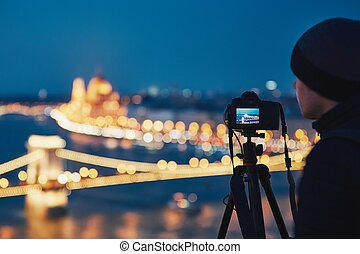 Photographer in the night city