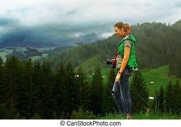 photographer in Ukraine Carpathians shoots a landscape