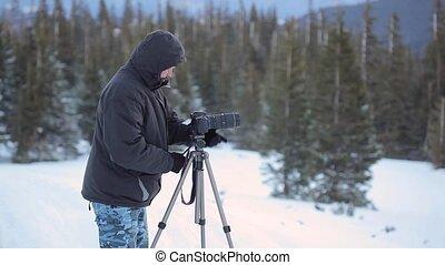 Photographer in winer mountain - Photographer work outdoor,...