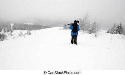 Photographer in winter mountain - Photographer take a shoot...