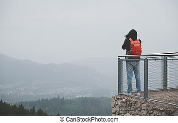 Photographer is taking a picture of mountains