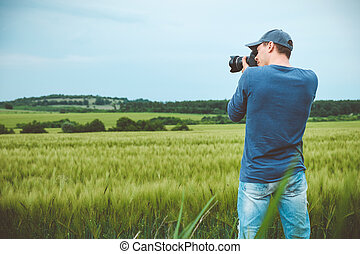 Photographer is taking a picture of scenic landscape.