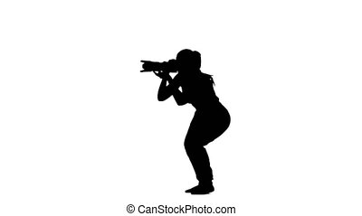 Photographer makes the pictures with various angles. Silhouette. White background