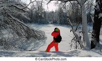 Photographer making a photo of frozen lake. - Photographer...