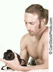 Photographer man with Muscular Build checks camera - Young...