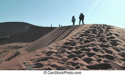 Photographer on big daddy dune,Soussuvlei,Namibia,Africa....