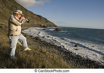 Photographer on the coast