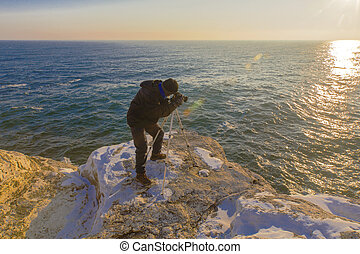 Photographer on the rocks
