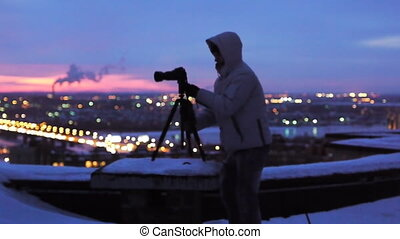 photographer on the roof - The photographer works on a roof...
