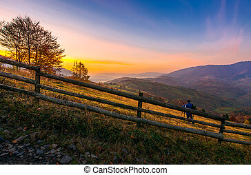 photographer on workshop at dawn in mountains. capturing...