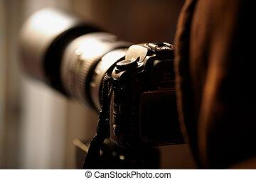 Photographer - paparazzi with telephoto Lens,natural sunset...
