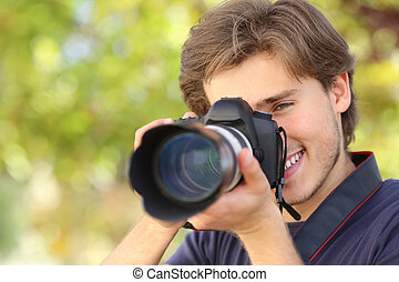 Photographer photographing and learning with a dslr digital camera