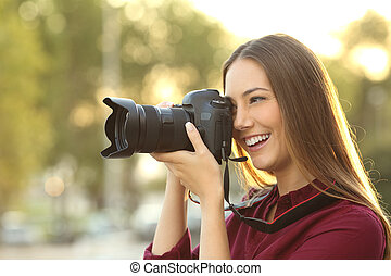 Photographer photographing with a digital camera