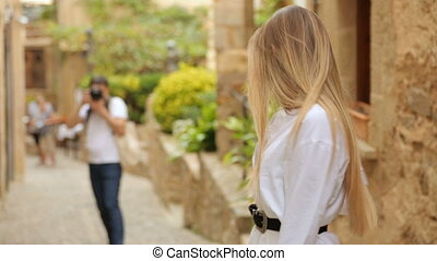 Photographer photographing young beautiful woman