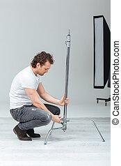 Photographer preparing lighting equipment - Male ...