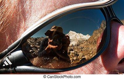 Photographer rereflecting on glasses