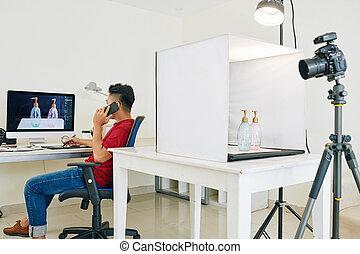 Photographer retouching photo