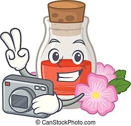 Photographer rose seed oil the cartoon shape