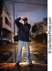 Photographer shooting at twilight in a city