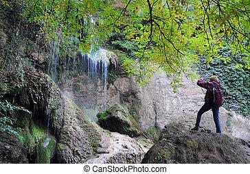 Photographer Shoots Waterfall