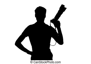 Photographer. Silhouette of man holding digital camera while...