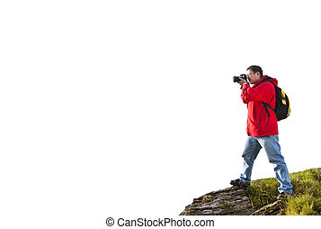 photographer standing on the top of mountain isolated on white