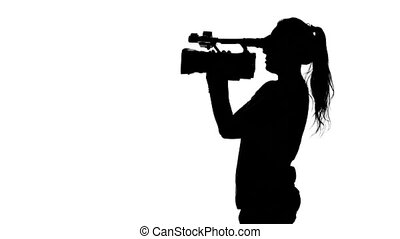 Photographer starts to shoot. White. Silhouette