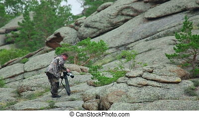 Photographer prepared to take pictures in the mountains