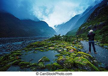 photographer take a photograph in franz joseft glacier south...
