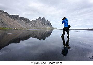 Photographer take photo near famous Stokksnes mountains