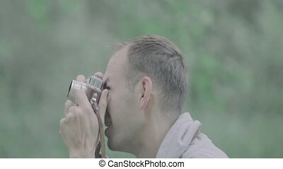 Photographer takes pictures with camera. - Photographer...