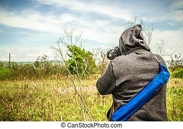 Photographer taking a landscape sho