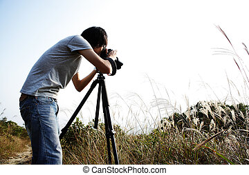 photographer taking photo in country side