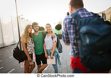 Photographer taking photo of friends