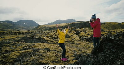Photographer taking photo of the tourist woman in the...