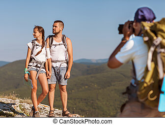 photographer taking photos in the mountains