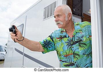photographer taking photos outside mobile motor home