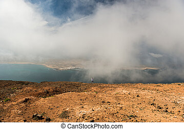 photographer taking picture in mist on Lanzarote