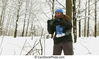 Photographer Taking Pictures In Winter Forest