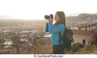 Photographer taking pictures outdoors in slow motion