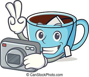 Photographer tea cup mascot cartoon