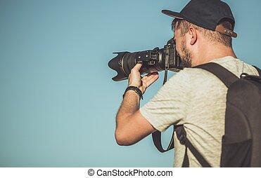 Photographer Telephoto Lens - Caucasian Photographer with...