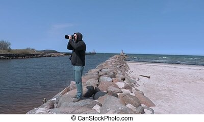 Photographer traveler take photos on the jetty