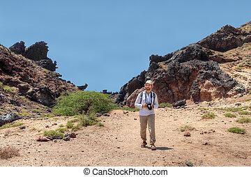 Photographer traveler walking in Hormoz Island, Hormozgan Province, southern Iran.