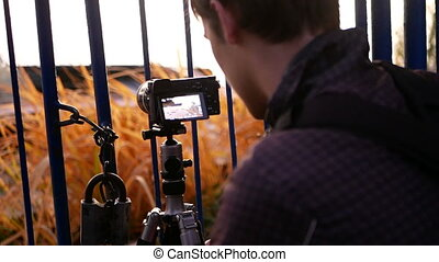 Photographer tripod camera - The photographer works near the...