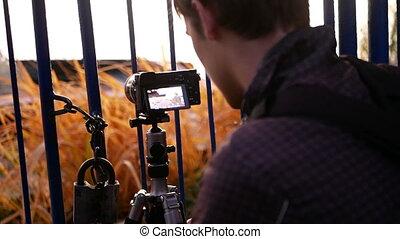 Photographer tripod camera - The photographer works near the...