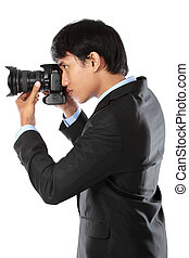 photographer using dslr camera