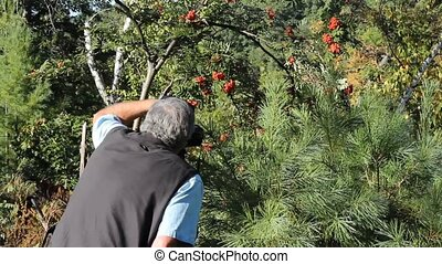 photographer sets up his camera to take a nature shot