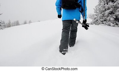 Photographer walks in winter mountain - Photographer take a...