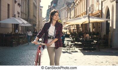 Photographer Walks with Bike - Amateur photographer walking...